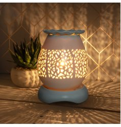 Create a stylish and ambient home with this attractive aroma lamp, complete with dimmer setting.