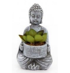 A small sitting decorative Buddha complete with an artificial succulent