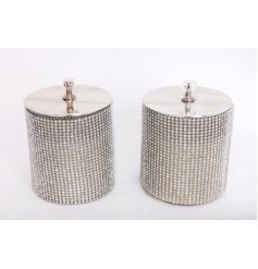 An assortment of fragranced candles wonderfully displayed in glitzy silver diamonte pots