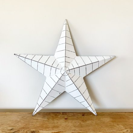 A chic and stylish white metal barn star with black, distressed ridges.