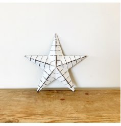 A rustic white metal barn star with ridges and a distressed finish.