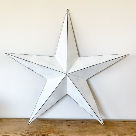 A vintage inspired white barn star with a rustic, distressed finish.