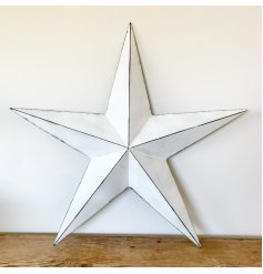 A vintage inspired white metal barn star with black edging, highlighting the three-dimensional points.