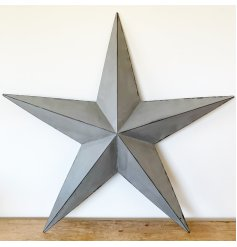 A rustic grey metal barn star with distressed detailing. Perfect for making a statement inside or outside of the home.