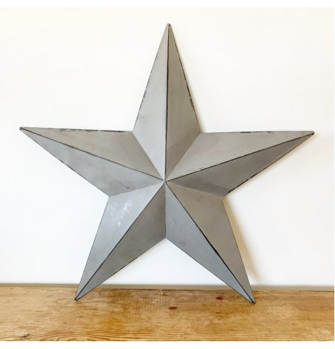 Make a statement inside and outside of the home this season with this large, on trend barn star