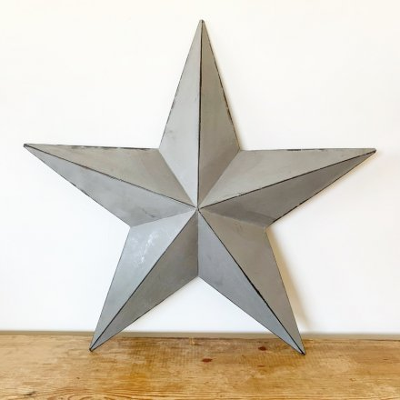 A stylish grey metal barn star with distressed detailing. Hang on walls or display on shelves.