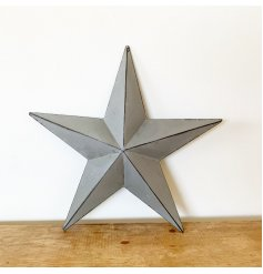 A vintage inspired grey metal barn star with distressed detailing on each three-dimensional point.
