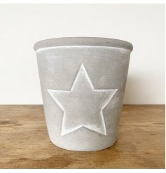 A chic cement planter with an embossed white star, decorated with a subtle white line. This is also mirrored in the rim