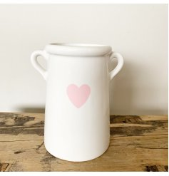A shabby chic style ceramic vase with a pretty pink heart decal. Complete with twin handles.