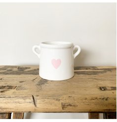 A shabby chic style pot planter with handles. Complete with a pretty pink heart decal.