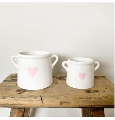 A chic white pot with an attractive pink heart decal. Complete with twin handles.