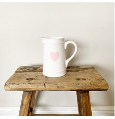 A chic white ceramic jug with a pretty in pink heart shaped design.