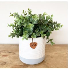 A contemporary grey and white ribbed planter with a PU Leather love tag.