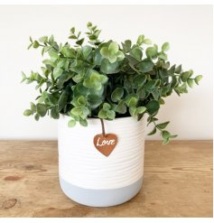 A chic and stylish pot with a ribbed surface finish. In grey and white block colours, complete with PU Leather tag.