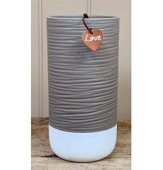 A two tone coloured ceramic pot with an faux leather heart tag and added ridge decal