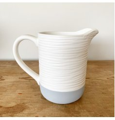 A contemporary colour block jug with a beautiful textured surface finish.