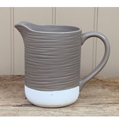 A two tone coloured ceramic jug with an added ridge decal and sleek smooth finish