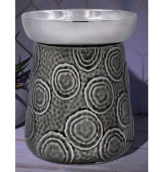 A sleek ceramic oil burner set with a distressed charcoal and grey finishing with an added embossed circle decal surroun