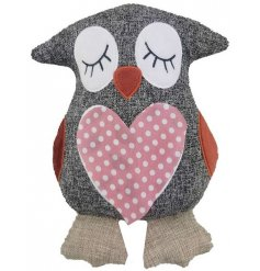 A cute grey fabric owl doorstop complete with added polka dot patterns