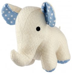 A little white knitted elephant doorstop complete with large blue polka dot ears