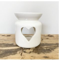 Fall in love with this simple and chic oil burner with a heart shaped cut out design.