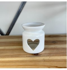 A chic ceramic oil burner in white with a heart shaped cut out design. Perfect for your most loved wax melts.