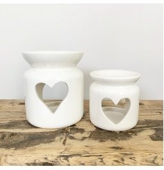A chic ceramic oil burner with a heart shaped cut out design.