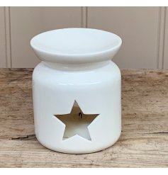 A chic and stylish oil burner with a star shaped cut out design.