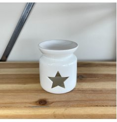 A chic and stylish oil burner in white, complete with a star shaped cut out design.