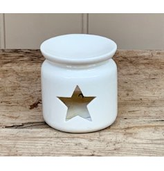 A grey ceramic oil burner with a stylish star shaped cut out design.