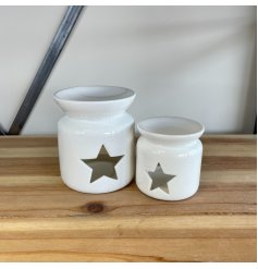 A chic and stylish ceramic oil burner in white. Complete with a star shaped cut out design.