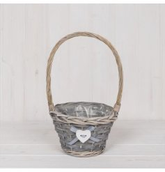 A natural wicker basket set with an added checkered bow and white heart decal