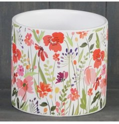 A medium sized ceramic pot beautifully decorated with a colourful meadow inspired print