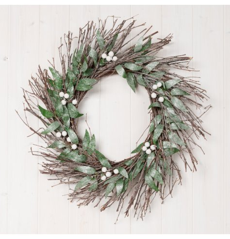 This twig and foliage covered wreath is decorated with a dusting of glitter