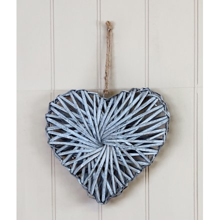 A rustic living rattan heart wreath with a grey washed finish and stylish jute string hanger.