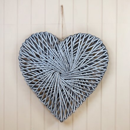 A stylish heart shaped wreath made from grey washed rattan.