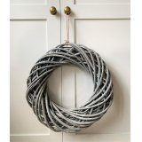 An small and simple round wreath set with a chic entwined rattan decal