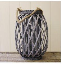 A large grey woven rustic lantern