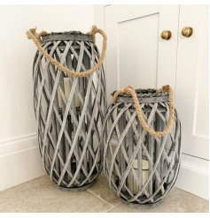 A tall grey woven lantern with chunky rope handle