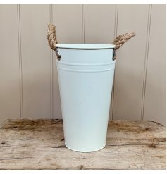A chic and simple cream flower bucket with rope handles.