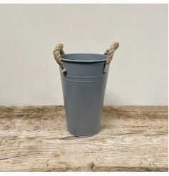 A rustic living flower bucket in grey. Complete with chunky rope handles.