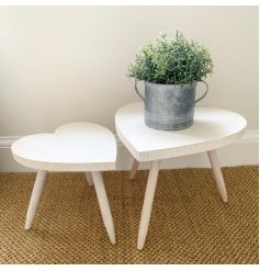 Set with its smooth natural wooden charm, this large heart-shaped stool will be sure to add a simple sweetheart feature