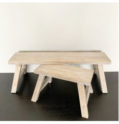 A set of 2 charming wooden potting benches. Each has a washed, distressed finish and is perfectly sized