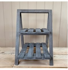 A natural wooden 2 Tier A-Frame Display Stand set with a rustic grey washed tone to it
