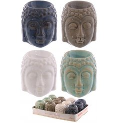 An assortment of four smooth glazed buddha head oil burners in a variety of colours