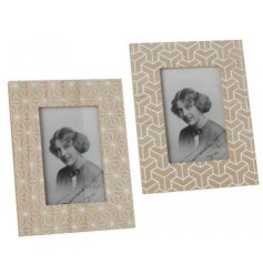 Charming and on trend accessories to have in any home, an assortment of wooden picture frames complete with geometric d