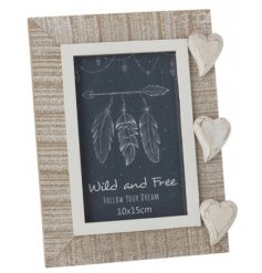 A natural wooden picture frame set with a distressed white washed tone and added wooden heart feature