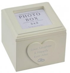 A small and delicate little wooden box set with a scripted text decal and space to display a treasured memory