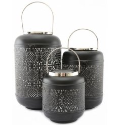 A beautifully themed set of assorted sized lanterns, each covered with a matte black tone and intricate pattern detail