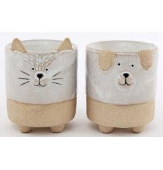 An assortment of Cat and Dog themed ceramic oil burners with smooth glazing finishes